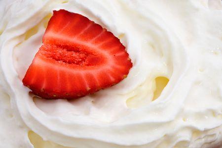 soften: a red strawberry on white cream