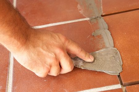 bricklayer hand putting cement