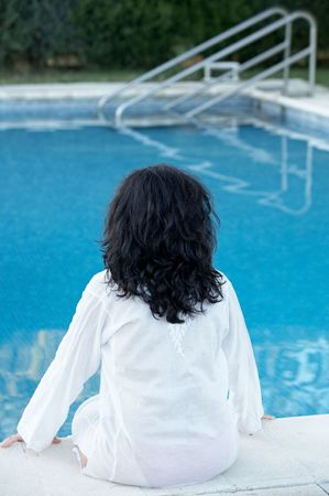 the water is a girl in a swimming pool seeing photo