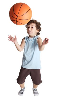 boy playing the basketball with white bottom that almost receives a blow from a ball Stock Photo - 603000