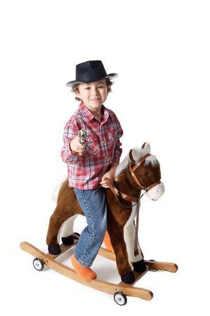 COWBOY  white bottom mounted white bottom in a toy horse photo