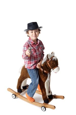 COWBOY  white bottom mounted white bottom in a toy horse photo