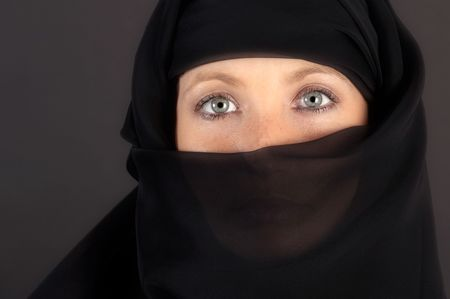 Beautiful eyes looking from above her veil Stock Photo - 613508
