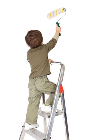 photo of an adorable boy painting a over white background