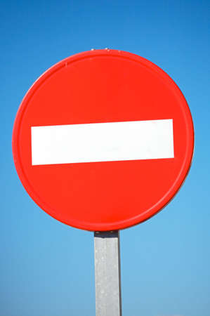 prohibitive: photo of a traffic signal a over blue background