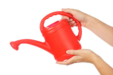 wateringcan: hands and a WATERING-CAN a over white background Stock Photo