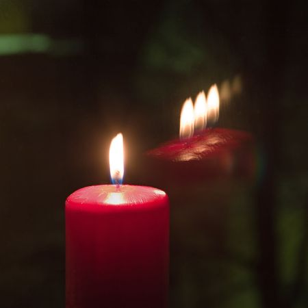 triplex: candle flame and reflections