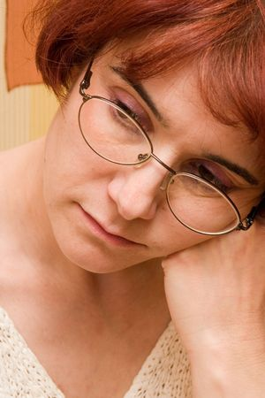 receptive: Dark-haired lady with spectacles Stock Photo