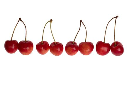 Four pairs of cherries on white background Stock Photo