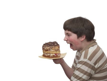 homemade cake: What a titbit! - A boy champing at the bit of home-made cake