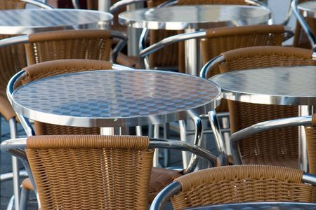 Tables and chairs in the alfresco cafe Stock Photo