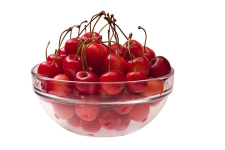 Cherries in a glass bowl - side view. Isolated on a white background