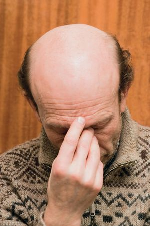 Man immersed in deep self-contemplation Stock Photo - 554890