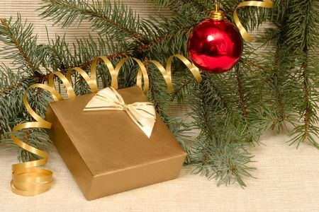 Hanging ball, gift box, streamer and spruce branch, Christmas concept photo
