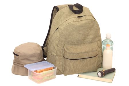 Hiking objects ready to pack in backpack, on white background, isolated