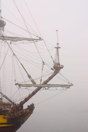 Sailing-ship embark on an unchartered sea.Way through the mist. photo