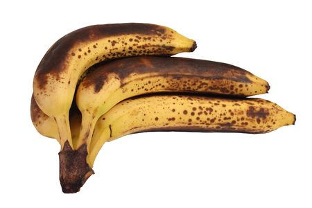 perishable: Hand of overripe and decaying bananas on white background, isolated