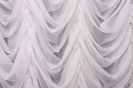 Hanging draped white curtain Stock Photo