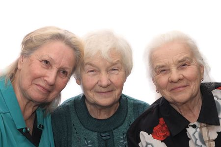 Three old women smiling, isolated on white background Stock Photo