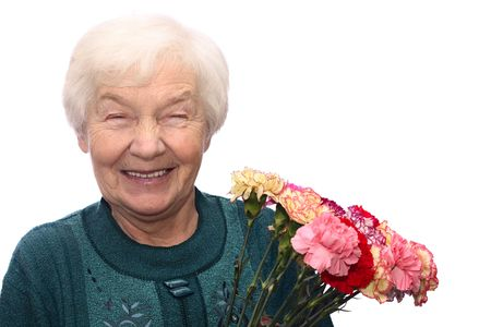 Smiling old woman with bunch of flowers, isolated on white background Stock Photo