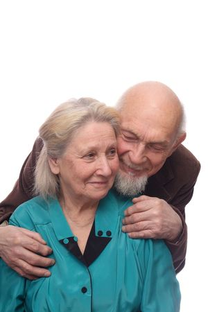 Senior couple, man embracing shoulders of his wife, isolated on white background photo