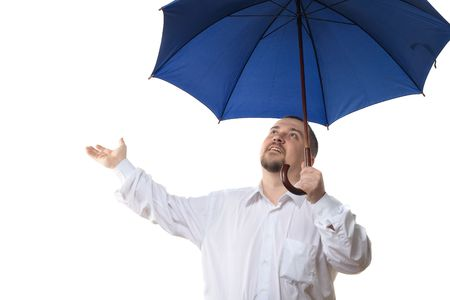 Man in white shirt under dark blue umbrella, isolated on white background photo
