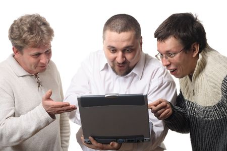 Three men with notebook looking at screen with surprise, isolated on white background photo