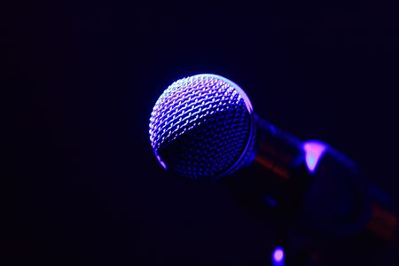Rock concert series: microphone, lit by purple and blue