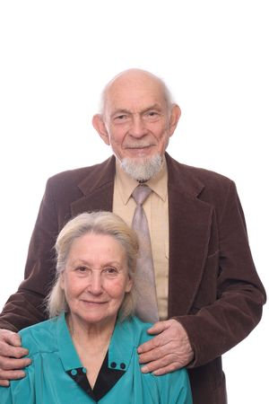 wizen: Senior couple, man embracing shoulders of his wife, isolated on white background Stock Photo