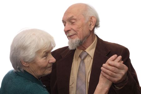 Senior couple dancing, man holding womans hand, isolated on white background