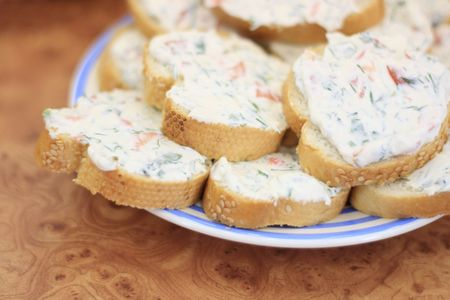 feta: Close up of a plate of sandwiches with cheese and vegetable spread Stock Photo