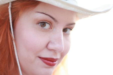 Face of young red-haired woman in white hat, isolated on white background Stock Photo - 1215300