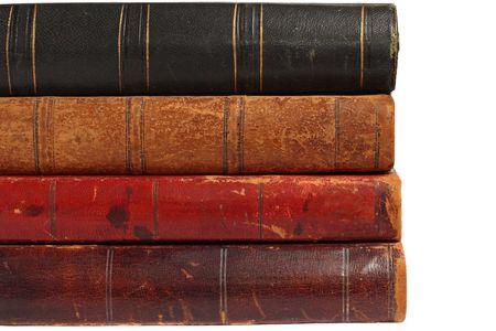Backs of four old books, isolated on white background Stock Photo