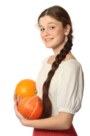 Young girl with two pumpkins, isolated on white background Stock Photo