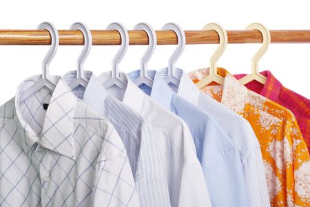 Concept of weekdays and weekend: five white-and-blue shirts and two bright-colored shirts