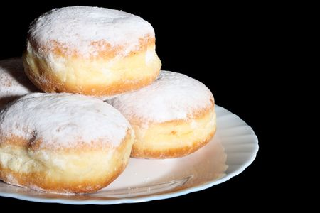 judaic: Doughnuts on white glass plate, isolated on black background