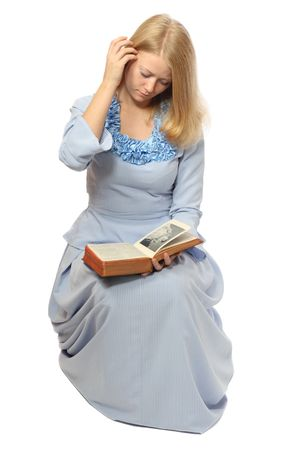 Girl in blue dress reading old book, isolated on white background