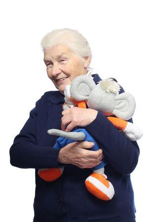 plushie: Senior woman with stuffed animal toy, isolated on white background