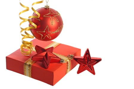 Christmas concept: hanging ball, two stars, streamer and gift box, isolated on white background photo