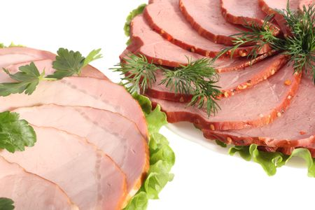 Plates with sliced ham and beef, close-up, isolated on white background Stock Photo
