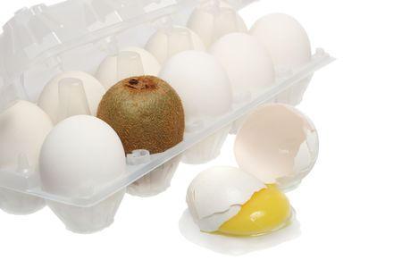 displaced: Box of eggs and broken egg displaced by kiwifruit, isolated on white background Stock Photo