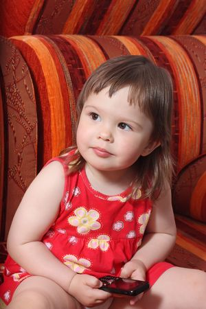 Two-year-old girl with mobile phone photo