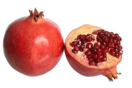 Pomegranate fruit and a half, isolated on white background Stock Photo - 3364292