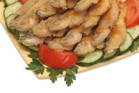 Fried fish with cucumbers, tomatoes and parsley, closeup, isolated on white background photo