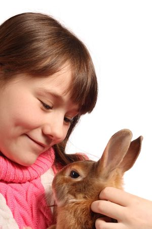 preteen girl: Cute preteen girl with pet rabbit, isolated on white background