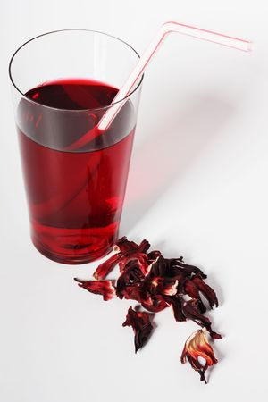 Dry hibiscus sepals and glass of hibiscus tea