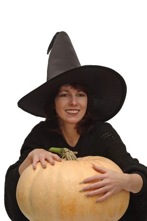 Smiling witch in black hat, with a large pumpkin, isolated on white background Stock Photo - 3642414