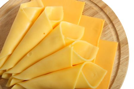 Cheese slices on wooden platter, isolated on white background