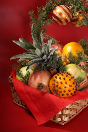 Decorated Christmas basket with fruit