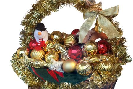 Christmas decoration: basket of baubles and tinsel, isolated on white background